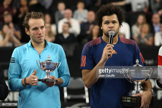 Finalist Lucas Pouille of France and winner JoWilfried Tsonga of France pose during the trophy ceremony following their final at the Open 13 an ATP...