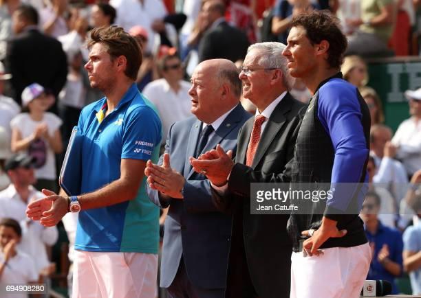 Finalist Stan Wawrinka of Switzerland FFT President Bernard Guidicelli Roy Emerson winner Rafael Nadal of Spain during the trophy ceremony following...