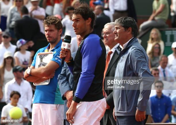 Finalist Stan Wawrinka of Switzerland winner Rafael Nadal of Spain Roy Emerson Toni Nadal during the trophy ceremony following the men's final on day...