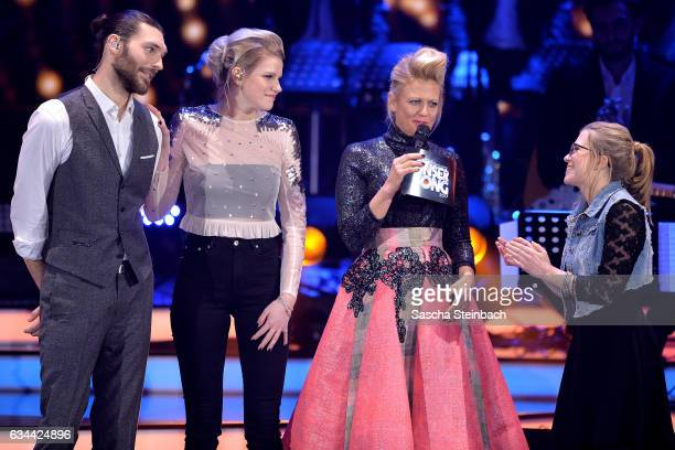 Finalists Axel Maximilian Feige Isabella 'Levina' Lueen and Barbara Schoeneberger react as Helene Nissen retires during the 'Eurovision Song Contest...