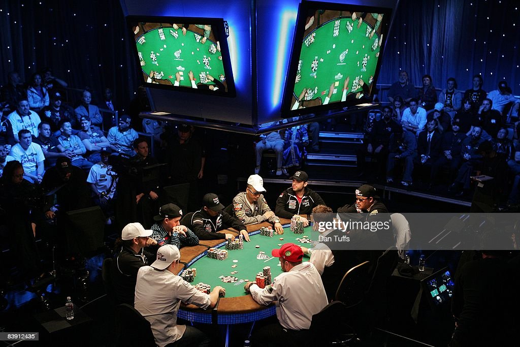 Finalists playing the final table of the World Series of Poker, Clockwise from red cap -Dennis Phillips, Craig Marquis,Ylon Schwartz, Scott Montgomery, Darus Suharto,DavidReheem,Ivan Demidov,Kelly Kim and Peter Eastgatein Las Vegas, Nevada on November 9, 2008.