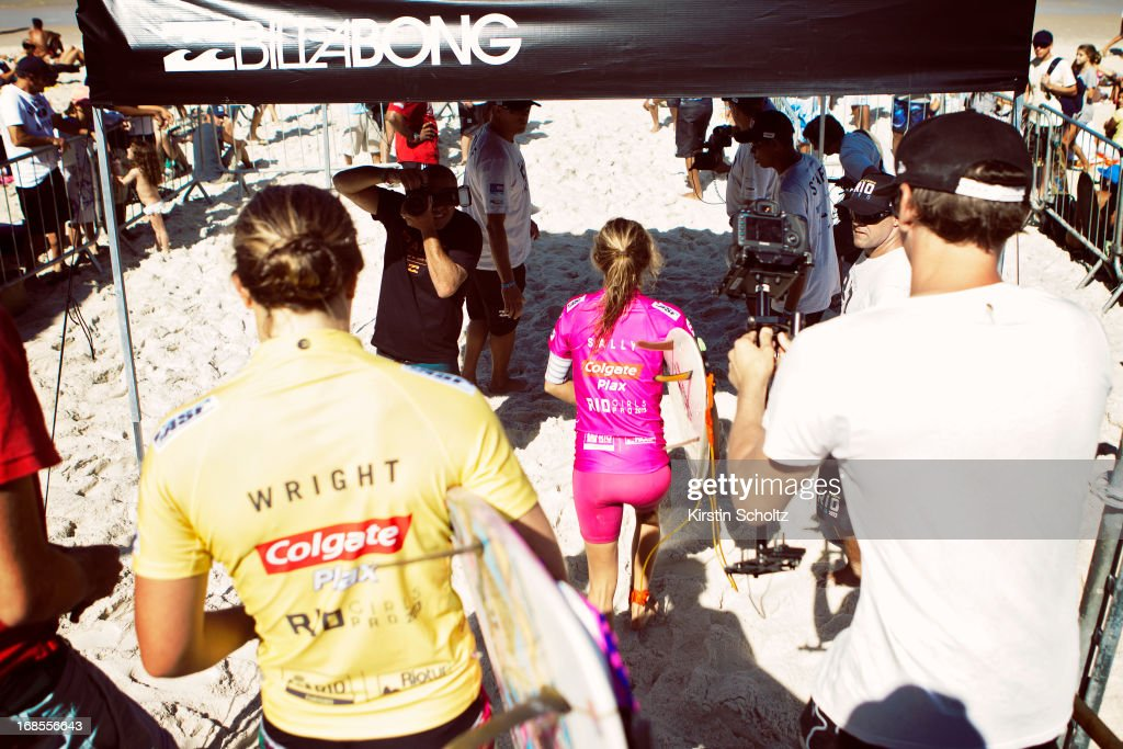 Finalists Tyler Wright (yellow) and Sally Fitzgibbons (pink) both of Australia make their way out for the final at the Colgate Plax Girls Pro on May 11, 2013 in Rio de Janeiro, Brazil.