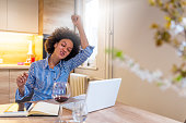 Successful businesswoman with clenched fists at home office. Successful business woman with arms up. Happy Businesswoman Raising Her Hand In Office. Success happens when you combine passion with ambit