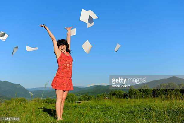 finally happy;woman throwing papers