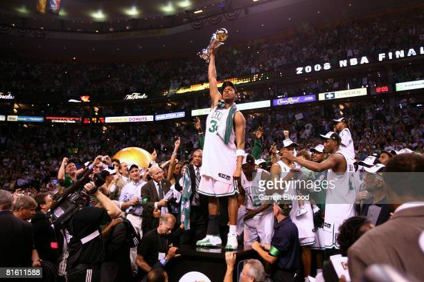 Finals MVP Paul Pierce of the Boston Celtics celebrates with the MYP trophy after the Celtics won 13192 against the Los Angeles Lakers to win the NBA...