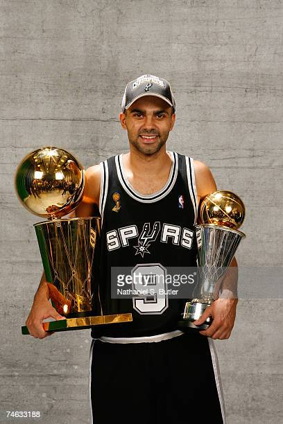 Finals MVP Tony Parker of the San Antonio Spurs pose for a portrait with the Larry O'Brien Championship trophy after they won the 2007 NBA...