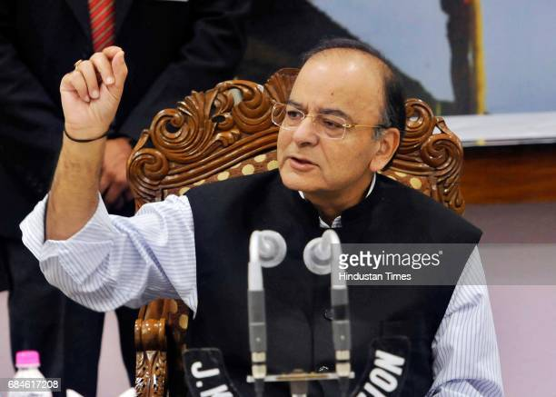 Finance Minister Arun Jaitley addresses a press conference on May 18 2017 in Srinagar India The finance ministers Finance Secretaries and other...