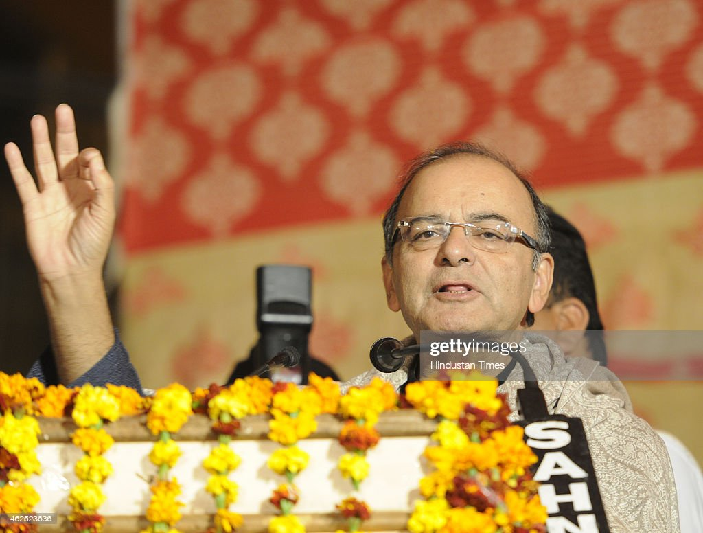 Finance Minister <a gi-track='captionPersonalityLinkClicked' href=/galleries/search?phrase=Arun+Jaitley&family=editorial&specificpeople=2660950 ng-click='$event.stopPropagation()'>Arun Jaitley</a> addressing a public meeting on the support of BJP Moti Nagar candidate Subhash Sachdev for the upcoming Delhi Assembly Elections at Ramesh Nagar on January 30, 2015 in New Delhi, India. Polling in Delhi will be held on February 7 and the counting of votes will take place on February 10.