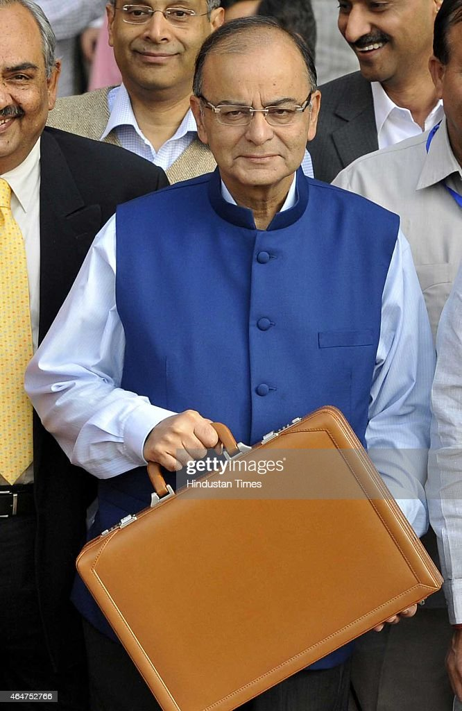 Finance Minister <a gi-track='captionPersonalityLinkClicked' href=/galleries/search?phrase=Arun+Jaitley&family=editorial&specificpeople=2660950 ng-click='$event.stopPropagation()'>Arun Jaitley</a> holding budget papers and his MOS Jyant Sinha (R) with Finance Secretaries leaving his office for the Parliament to present General budget 2015-16 on February 28, 2015 in New Delhi, India. Jaitley promised higher investment in India's decrepit roads and railways, offered the carrot of corporate tax cuts to global corporations and the stick of tighter compliance rules to get Indian tycoons to invest at home rather than stash wealth abroad. He forecast inflation at 5% by the end of the fiscal year ending March 2016, undershooting the Reserve Bank of India's 6% target and creating room to cut interest rates. Annual inflation was 5.1% in January. He proposed to abolish the wealth tax and proposed two percent surcharge on the super rich. He said the government is proposing to rationalise various tax exemptions and incentives to reduce tax disputes and improve tax administration.