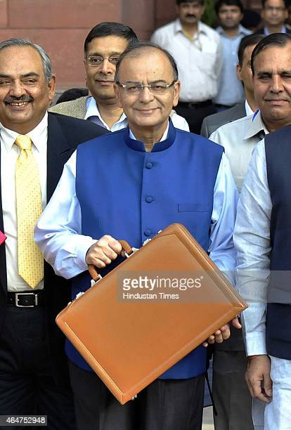 Finance Minister Arun Jaitley holding budget papers and his MOS Jyant Sinha with finance secretaries leaving his office for the Parliament to present...