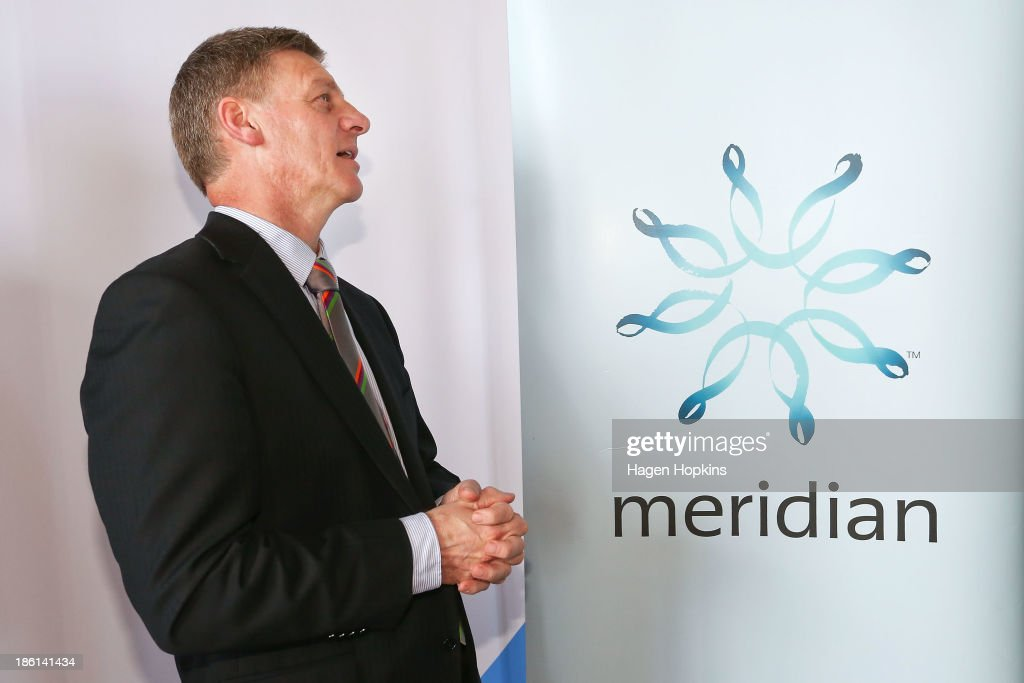 Finance minister Bill English checks the opening share price during the listing of Meridian Energy at NZX on October 29 2013 in Wellington New...