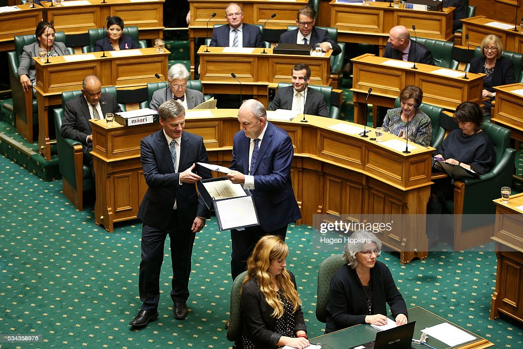 Finance Minister <a gi-track='captionPersonalityLinkClicked' href=/galleries/search?phrase=Bill+English&family=editorial&specificpeople=772458 ng-click='$event.stopPropagation()'>Bill English</a> delivers copies of his budget to MPs with the help of Economic Development Minister Steven Joyce during the 2016 budget presentation at Parliament on May 26, 2016 in Wellington, New Zealand. English delivered his eighth budget which sees record investment in health and education and more support for businesses to create jobs on the back of a growing economy.