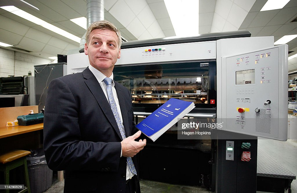 Finance Minister Bill English holds a copy of the 2011 budget at Printlink during the printing of the budget on May 18 2011 in Wellington New Zealand...