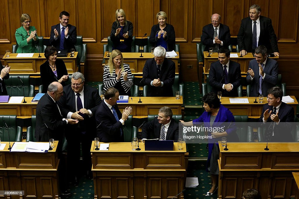 Finance Minister Bill English is applauded by fellow National MPs and Prime Minister John Key during the 2014 budget presentation at Parliament on...