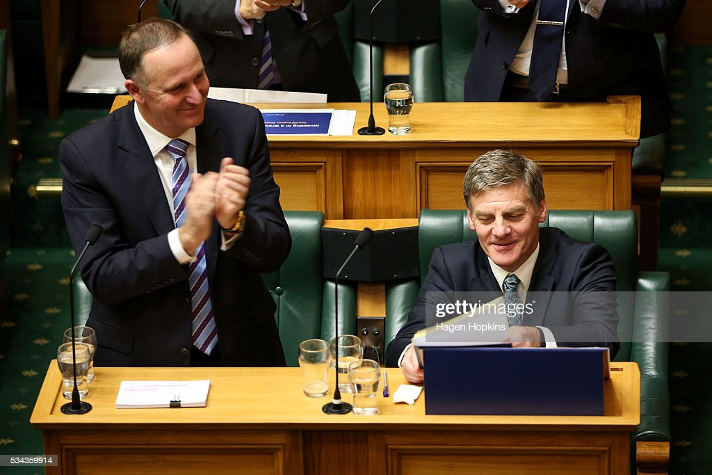 Finance Minister <a gi-track='captionPersonalityLinkClicked' href=/galleries/search?phrase=Bill+English&family=editorial&specificpeople=772458 ng-click='$event.stopPropagation()'>Bill English</a> is applauded by Prime Minister <a gi-track='captionPersonalityLinkClicked' href=/galleries/search?phrase=John+Key&family=editorial&specificpeople=2246670 ng-click='$event.stopPropagation()'>John Key</a> after delivering the budget during the 2016 budget presentation at Parliament on May 26, 2016 in Wellington, New Zealand. Finance Minister <a gi-track='captionPersonalityLinkClicked' href=/galleries/search?phrase=Bill+English&family=editorial&specificpeople=772458 ng-click='$event.stopPropagation()'>Bill English</a> his eighth budget sees record investment in health and education and more support for businesses to create jobs on the back of a growing economy.