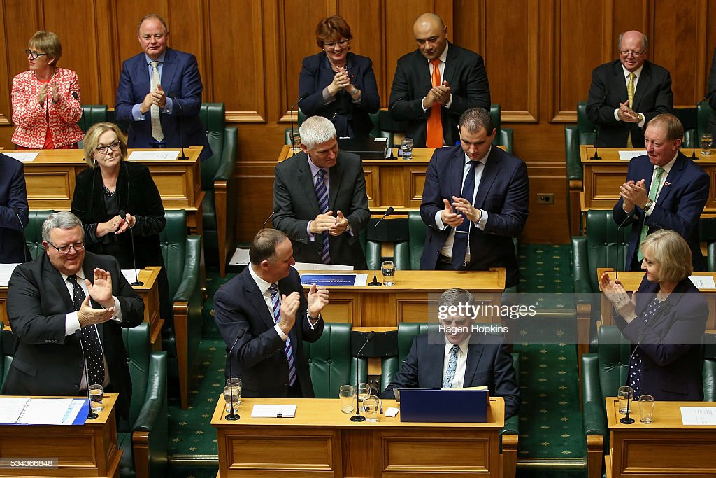 Finance Minister <a gi-track='captionPersonalityLinkClicked' href=/galleries/search?phrase=Bill+English&family=editorial&specificpeople=772458 ng-click='$event.stopPropagation()'>Bill English</a> is applauded by Prime Minister <a gi-track='captionPersonalityLinkClicked' href=/galleries/search?phrase=John+Key&family=editorial&specificpeople=2246670 ng-click='$event.stopPropagation()'>John Key</a> and fellow National MPs after delivering the 2016 budget presentation at Parliament on May 26, 2016 in Wellington, New Zealand. English delivered his eighth budget which sees record investment in health and education and more support for businesses to create jobs on the back of a growing economy.