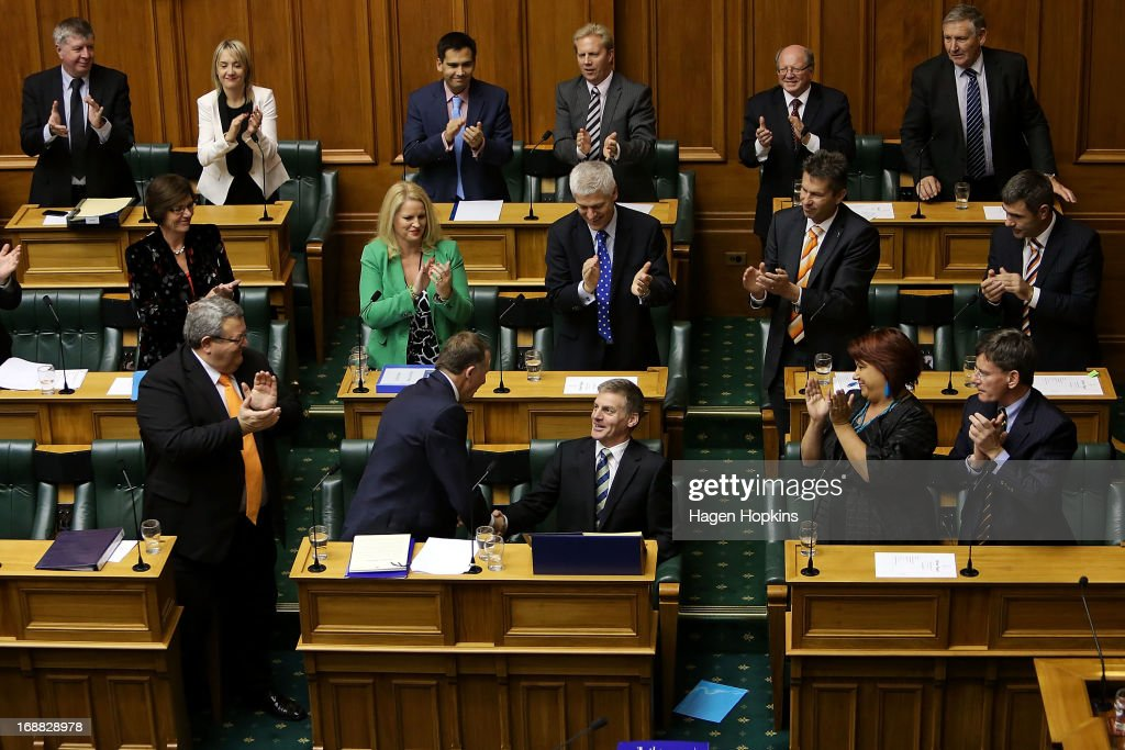Finance Minister Bill English is congratulated by Prime Minister John Key during the reading of the 2013 budget at Parliament on May 16 2013 in...