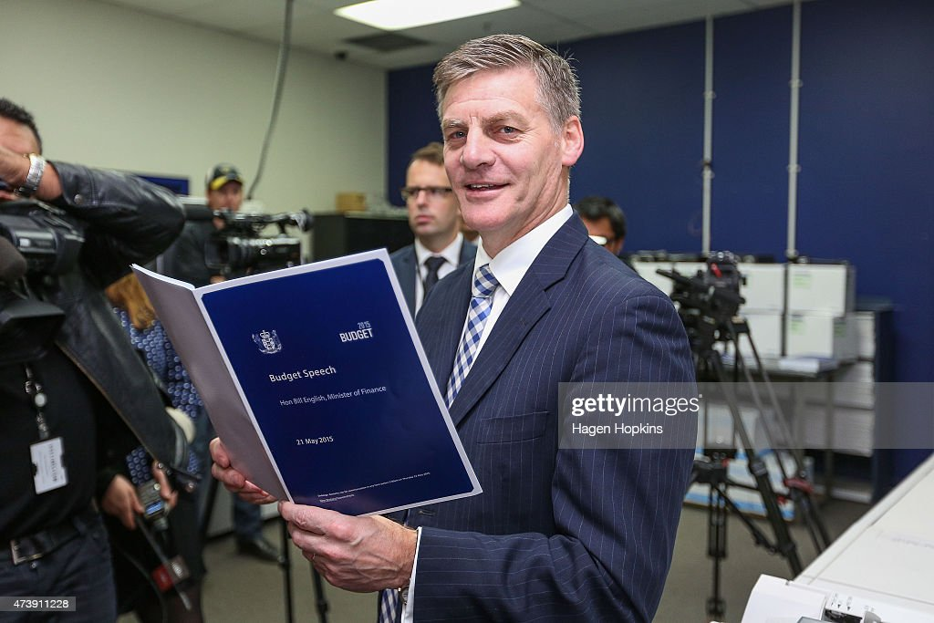 Finance Minister Bill English poses with a copy of his budget speech during the printing of the budget at Printlink on May 19 2015 in Wellington New...