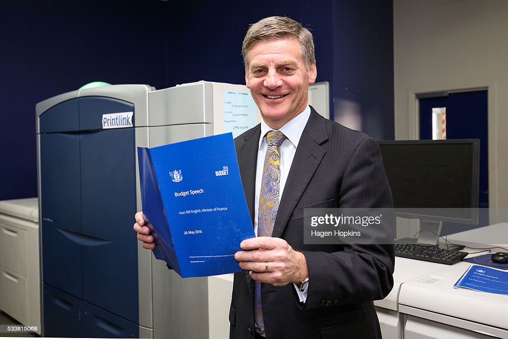 Finance Minister Bill English poses with a copy of his budget speech during the printing of the budget at Printlink on May 24 2016 in Wellington New...