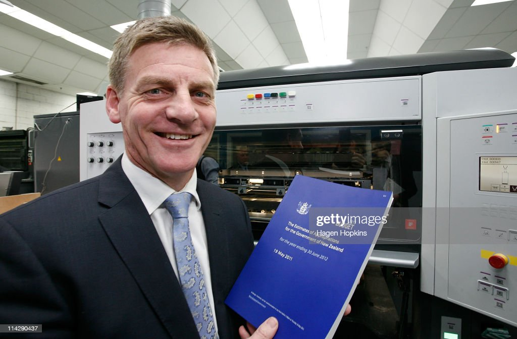 Finance Minister Bill English poses with a copy of the 2011 budget at Printlink during the printing of the budget on May 18 2011 in Wellington New...