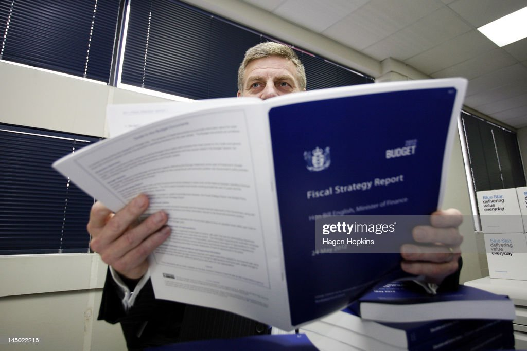 Finance Minister Bill English poses with a copy of the 2012 budget Fiscal Strategy Report during the printing of the budget at Printlink on May 23...