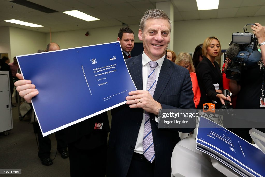Finance Minister Bill English poses with a copy of the Estimates of Appropriations during the printing of the budget at Printlink on May 14 2014 in...