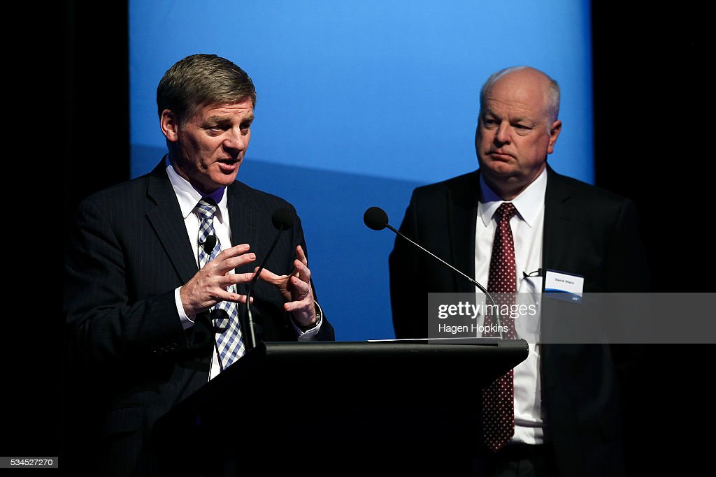 Finance Minister <a gi-track='captionPersonalityLinkClicked' href=/galleries/search?phrase=Bill+English&family=editorial&specificpeople=772458 ng-click='$event.stopPropagation()'>Bill English</a> speaks while ANZ CEO David Hisco looks on during a post-budget breakfast at Te Papa on May 27, 2016 in Wellington, New Zealand. The National party government yesterday delivered the budget, unveiling $761m in new spending for science and innovation, $2.2b investment in new health initiatives, along with investments in housing for Auckland and an increase in tobacco tax.