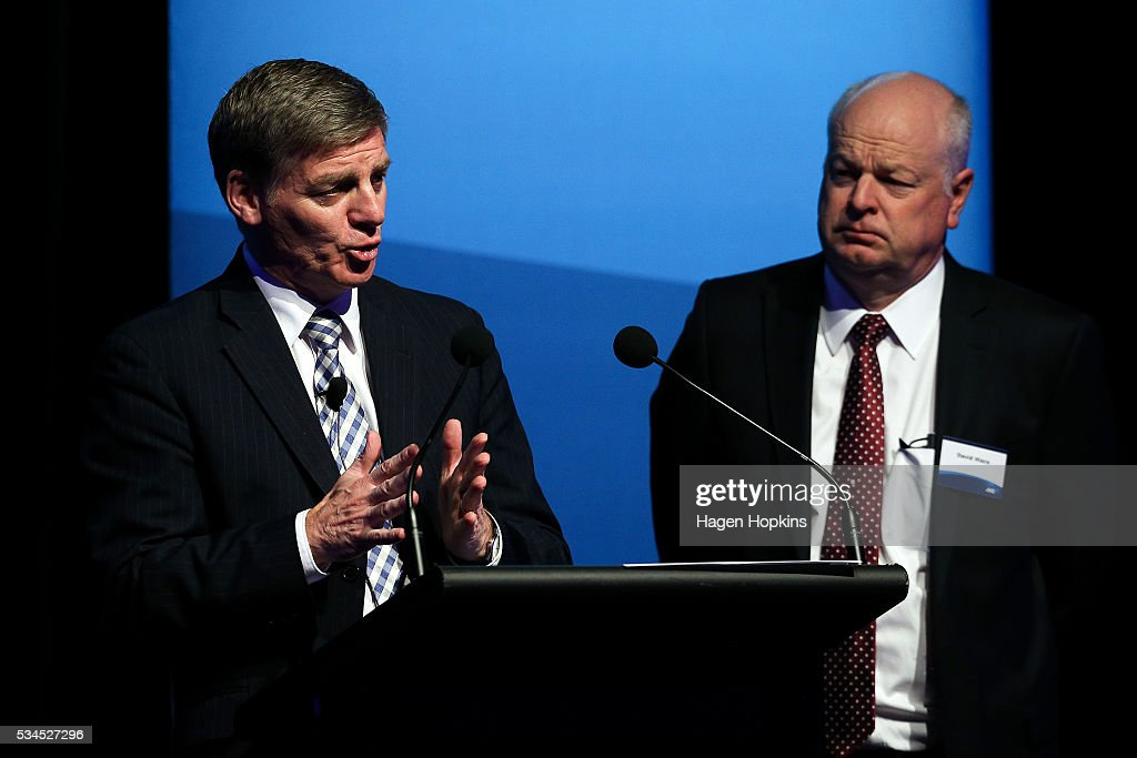 Finance Minister Bill English speaks while ANZ CEO David Hisco looks on during a post-budget breakfast at Te Papa on May 27, 2016 in Wellington, New Zealand. The National party government yesterday delivered the budget, unveiling $761m in new spending for science and innovation, $2.2b investment in new health initiatives, along with investments in housing for Auckland and an increase in tobacco tax.