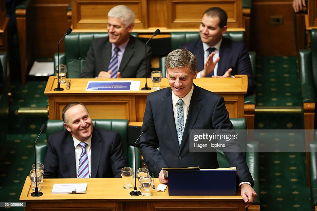 Finance Minister Bill English speaks while Prime Minister John Key looks on during the 2016 budget presentation at Parliament on May 26, 2016 in Wellington, New Zealand. English delivered his eighth budget which sees record investment in health and education and more support for businesses to create jobs on the back of a growing economy.