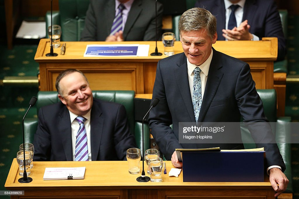 Finance Minister <a gi-track='captionPersonalityLinkClicked' href=/galleries/search?phrase=Bill+English&family=editorial&specificpeople=772458 ng-click='$event.stopPropagation()'>Bill English</a> speaks while Prime Minister <a gi-track='captionPersonalityLinkClicked' href=/galleries/search?phrase=John+Key&family=editorial&specificpeople=2246670 ng-click='$event.stopPropagation()'>John Key</a> looks on during the 2016 budget presentation at Parliament on May 26, 2016 in Wellington, New Zealand. English delivered his eighth budget which sees record investment in health and education and more support for businesses to create jobs on the back of a growing economy.