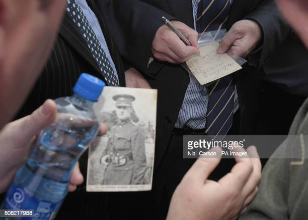 Finance minister Brian Lenihan signs pictures of Michael Collins at the annual Beal na mBlath commemoration in Skibbereen Cork where Free State...
