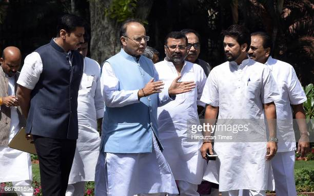 Finance Minister Defence Minister of Corporate Affairs Arun Jaitley talking to Lok Sabha MP from Hamirpur in Himachal Pradesh Anurag Thakur and other...