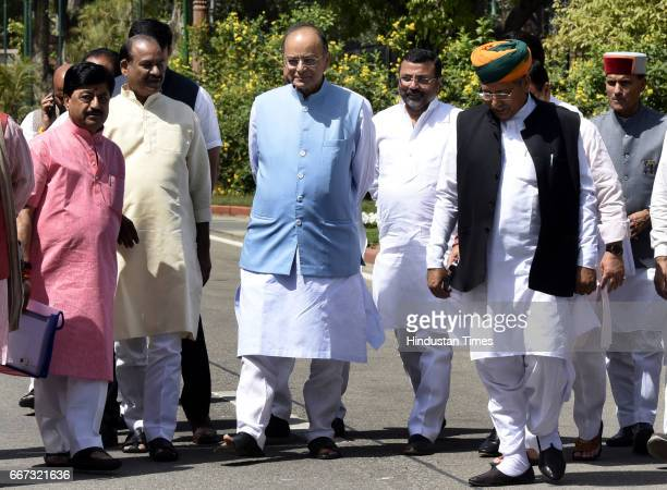 Finance Minister Defence Minister of Corporate Affairs Arun Jaitley talking to other BJP Members of Parliament after attending the BJP Parliamentary...