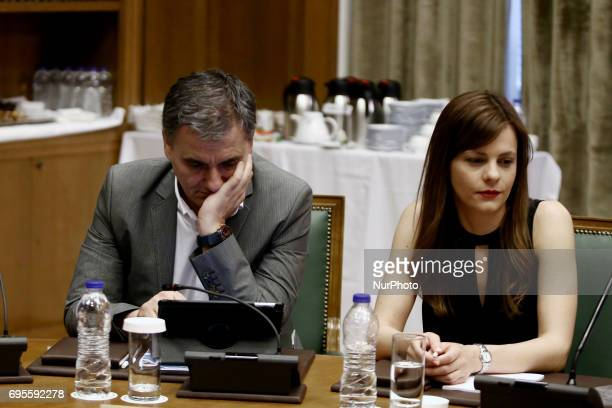 Finance Minister Euclid Tsakalotos and Labor Minister Efi Achtsioglouduring a Government cabinet meeting at Parliament in Athens on June 13 2017...