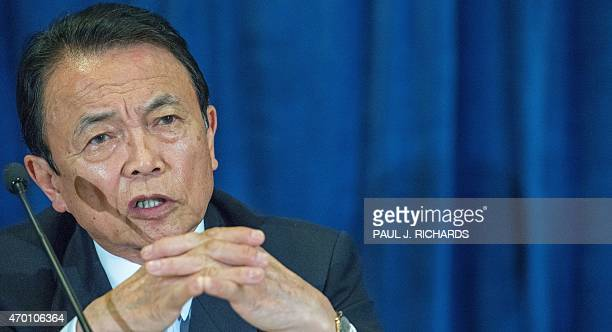Finance Minister of Japan Taro Aso listens to questions from reporters as he delivers remarks during a press conference April 17 at the Westin Hotel...