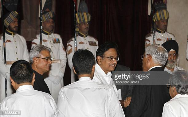 Finance Minister P Chidamabaram talking with outgoing CAG Vinod Rai with Shashi Kant Sharma before he took oath as Comptroller and Auditor General of...