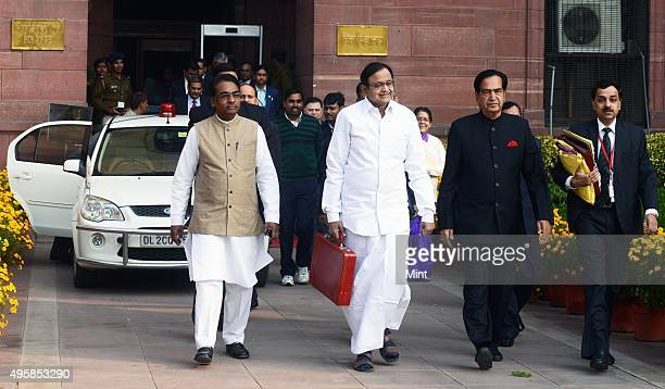 Finance Minister P Chidambaram flanked by his two colleagues JD Seelam and Namo Narain Meena coming out of the Finance Ministry going to present the...