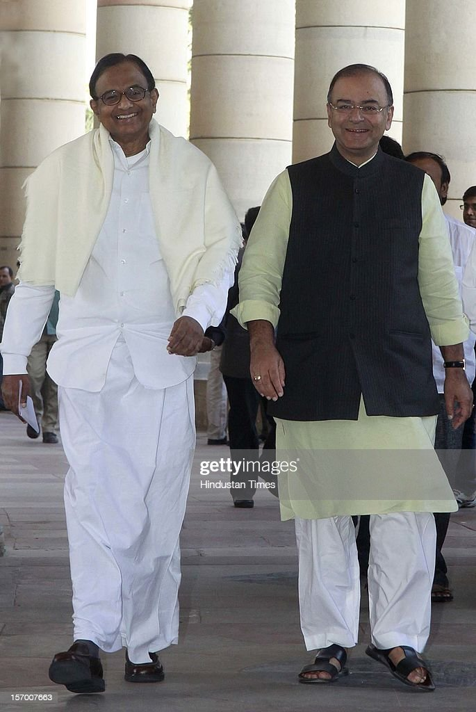 Finance minister P Chidambaram ( L) Leader of Opposition in Rajya Sabha Arun Jaitley, ( R) arrive attending all party meeting on to break the deadlock on Foreign Direct Investment issue during the Parliament winter session on November 26, 2012 in New Delhi, India. Main opposition party BJP wants debate under rule 184 which has provision of vote but government wants the speaker to decide on debate rules.