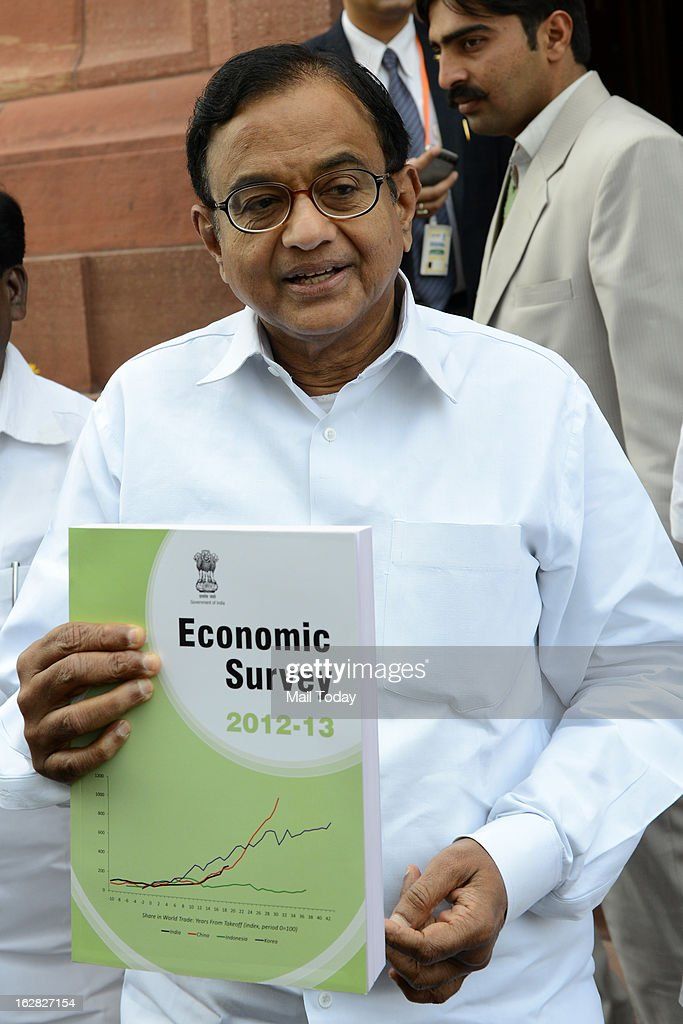 Finance Minister P Chidambaram showing a copy of Economic Survey 2012-13 during the ongoing budget session at Parliament House on Wednesday.
