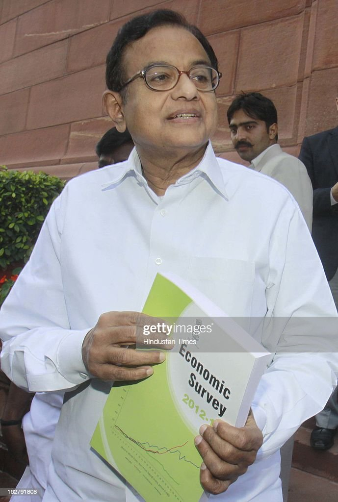 Finance Minister P. Chidambaram shows the copy of Economic survey 2012 – 2013 after it was tabled at Parliament House on February 27, 2013 in New Delhi, India. Authored by Chief Economic Adviser Raghuram Rajan, Economic survey present the report card on the state of the economy, with recommendations for the way forward.