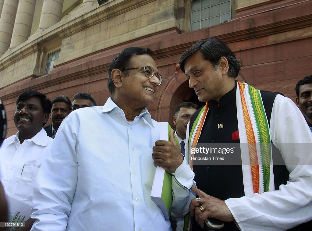 Finance Minister P. Chidambaram with Shashi Tharoor after he tabled Economic survey 2012 – 2013 at Parliament House on February 27, 2013 in New Delhi, India. Authored by Chief Economic Adviser Raghuram Rajan, Economic survey present the report card on the state of the economy, with recommendations for the way forward.