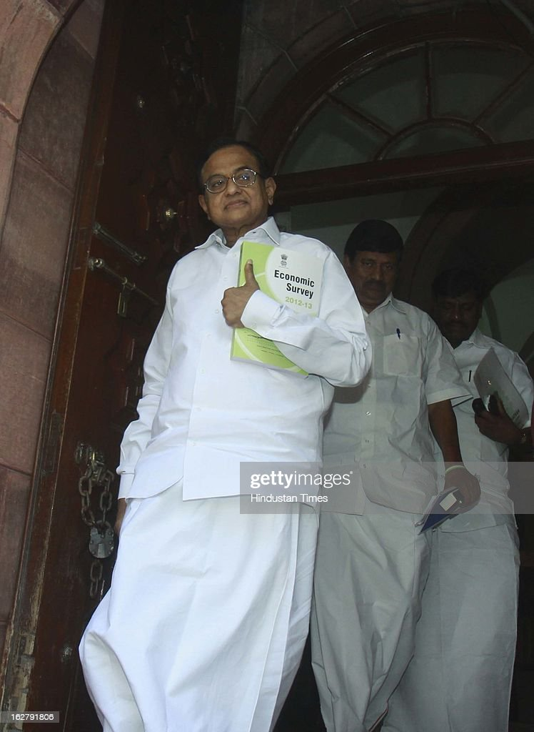 Finance Minister P. Chidambaram with the copy of Economic survey 2012 – 2013 after it was tabled at Parliament House on February 27, 2013 in New Delhi, India. Authored by Chief Economic Adviser Raghuram Rajan, Economic survey present the report card on the state of the economy, with recommendations for the way forward.