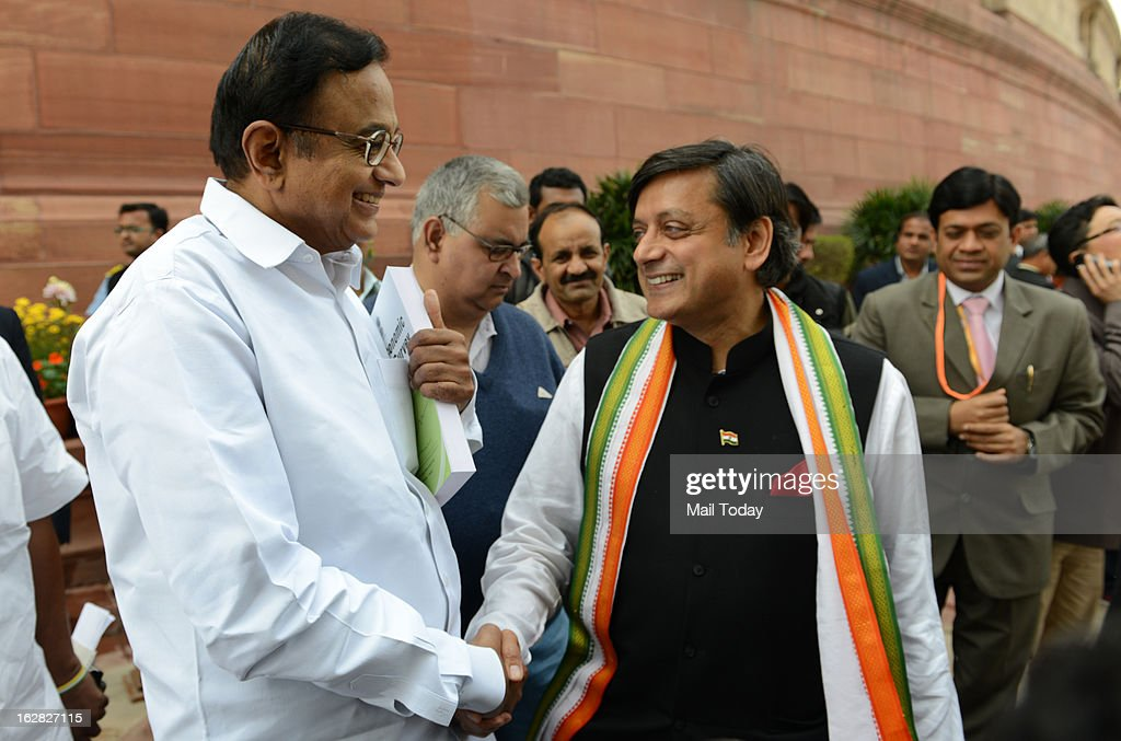 Finance Minister P Chidambaram with Union Minister of State for HRD Shashi Tharoor during the ongoing budget session at Parliament House on Wednesday.
