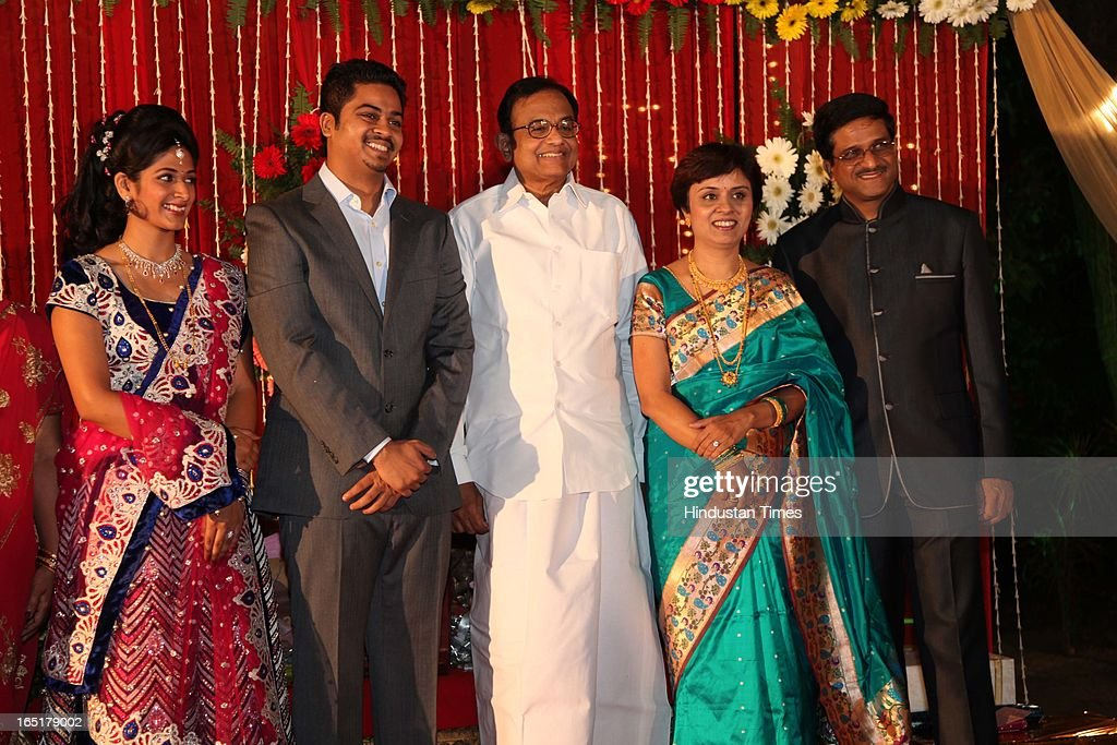 Finance Minister P Chidambram pose with couple Ameya Yeravdekar and Swati Thorat along with parents Vidya Yeravdekar and Satish Yeravdekar at their wedding reception at Delhi Gymkhana on March 22, 2013 in New Delhi, India.