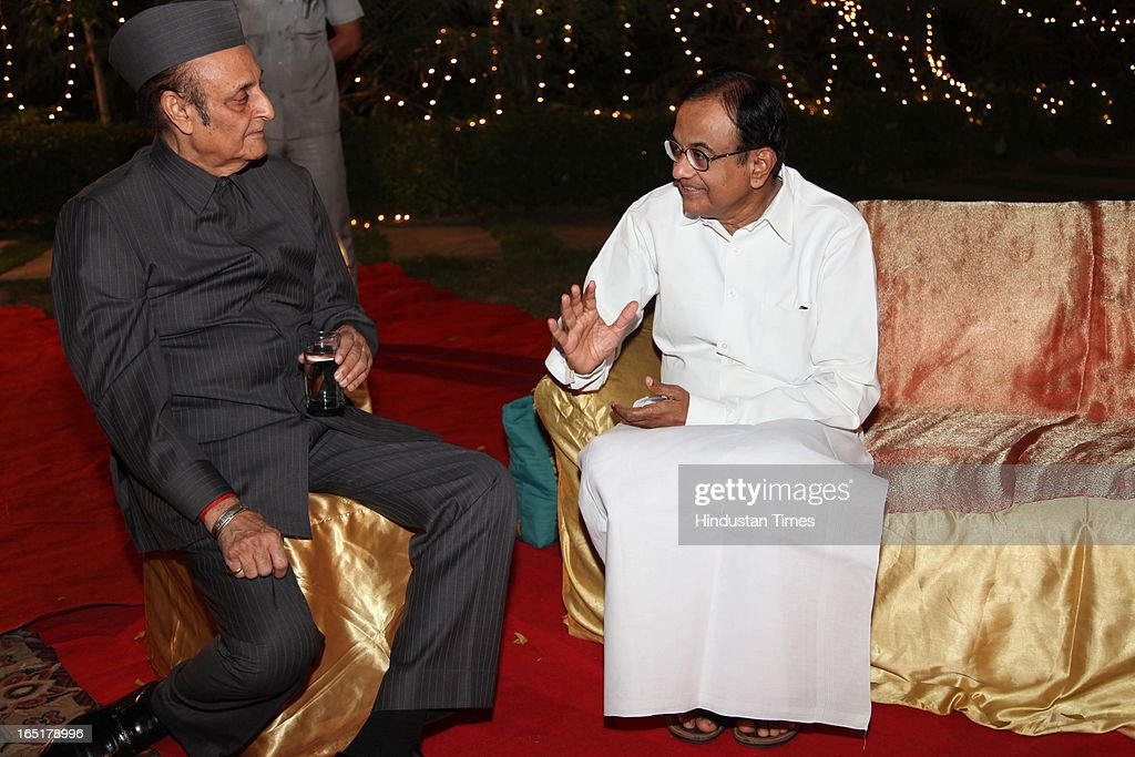 Finance Minister P Chidambram with veteran leader Karan Singh at the wedding reception of educationist Dr SB Mujumdar's grandson Ameya Yeravdekar and Swati Thorat at Delhi Gymkhana on March 22, 2013 in New Delhi, India.