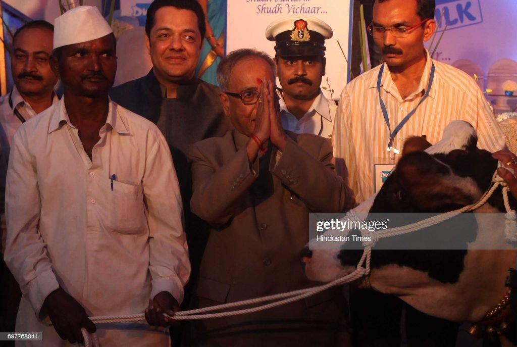 Finance Minister Pranab Mukherjee hands cattle to a farmer on finance scheme for marginal dairy organised by Dwarka Milk at Vashi on Monday.