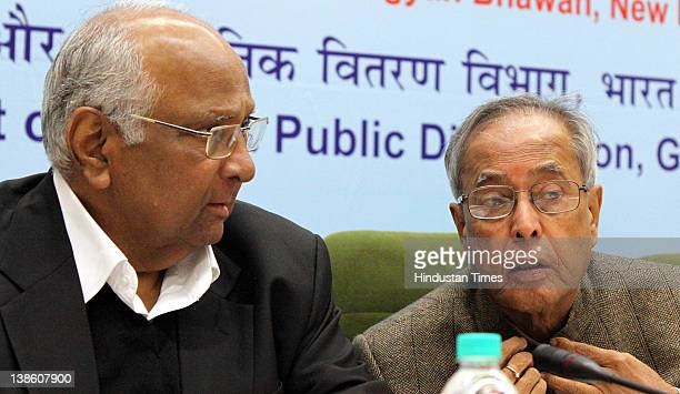 Finance Minister Pranab Mukherjee with Agriculture Minister Sharad Pawar during a conference to discuss issues related with targeted public...