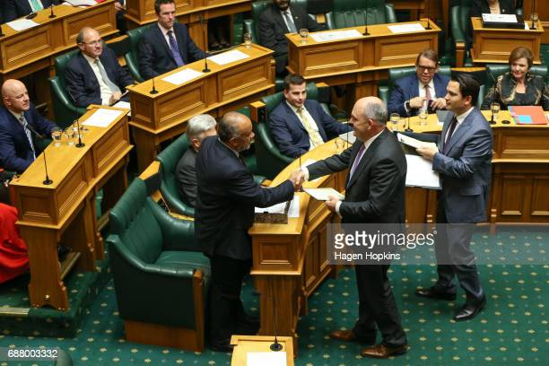 Finance Minister Steven Joyce delivers papers to Maori Party coleader Te Ururoa Flavell during the 2017 budget presentation at Parliament on May 25...