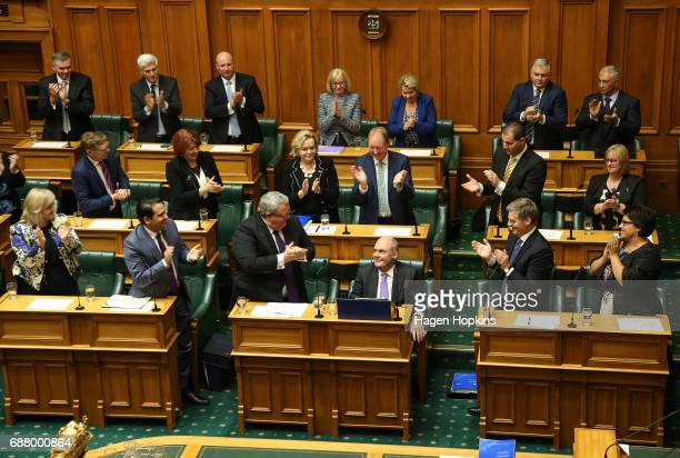 Finance Minister Steven Joyce is applauded by fellow MPs during the 2017 budget presentation at Parliament on May 25 2017 in Wellington New Zealand...