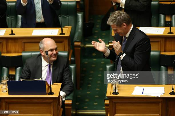 Finance Minister Steven Joyce is applauded by Prime Minister Bill English during the 2017 budget presentation at Parliament on May 25 2017 in...